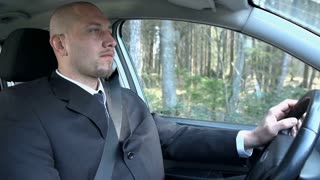 Slow Motion Businessman Driving Car In Woods