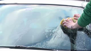Slow Motion Car Cleaning Windshield Close Up