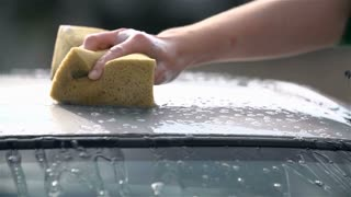 Slow Motion Car Roof Cleaning