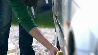 Slow Motion Carefully Washing Car Side Doors