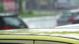SLOW MOTION: Close Up of Raining on Car Roof