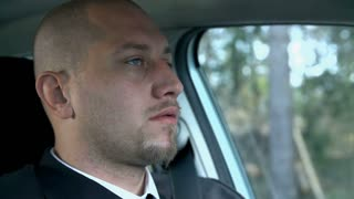 Slow Motion Close up On Business Man While Driving Car