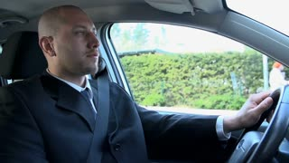 Slow Motion Man in Suit Driving Car