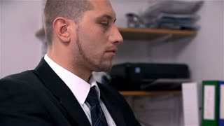 Slow Motion Of Business Man in Office Looking Up