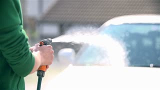 Slow Motion Spraying Car With Water