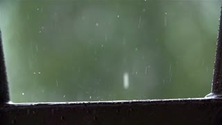 SLOW MOV: Extreme Close Up Rain Drops Bouncing