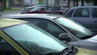 SLOW MOV: Rain Falling On Car Windshield