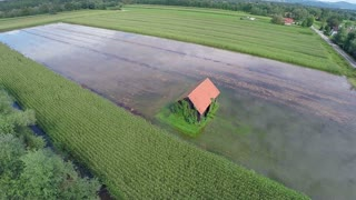 Top view of building in the middle of flooded field