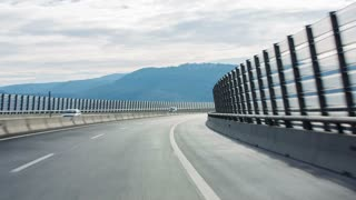 Vehicle ride on highway. Driving on highway with wind walls while sun shining on road making contrast image.