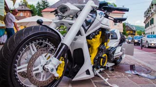 VELDEN, AUSTRIA - JUNE 2014: Street show supercars. Very expensive cars driving through town. Nice looking motorbike