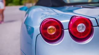 VELDEN, AUSTRIA - JUNE 2014: Street show supercars. Very expensive cars driving through town. Supercar Tail Lights