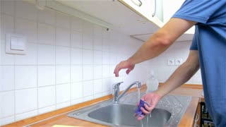 Washing Hands In Kitchen Sink. Young Attractive Man In New Home, Checking  And Cleaning