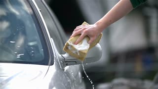 Wet Sponge Cleaning Car Slow Motion