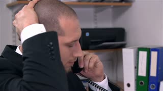 Worried Business Man Talking on Phone