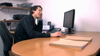 Young Business Man Happy At Work in Office