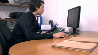 Young Business Man In Office Working on PC