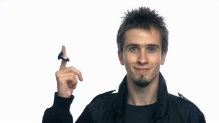 Young Man Rolling Car Keys on Finger