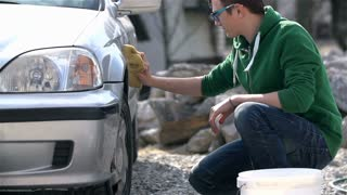 Young Man Washing His First Car in Slow Motion
