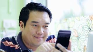 2015 06 1Happy Asian man using his smart phone0 -3.mov