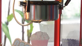 4K, A static shot of a commercial popcorn machine.