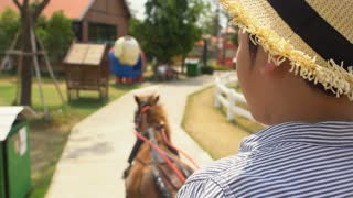 4k , Asian boy sit on carriage, moving on road