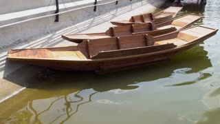 4k, Fisherman wooden boat on the river.