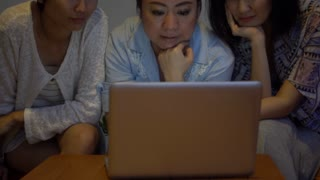 4k medium shot of asian female group resourcing information and talking. They using a digital laptop computer and wifi at home
