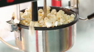 A static shot of a commercial popcorn machine.