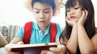 Asian child playing smart phone together