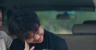 Asian Couple in love make fun in car