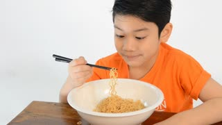 Asian cute boy eating chines noodle