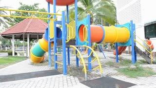 Asian cute boy playing in playground.