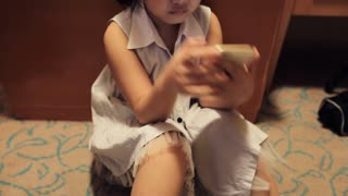 Asian girls playing a game on smart phone