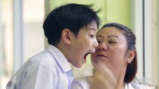 Asian Mom and her son kissing. Lovely close ups.