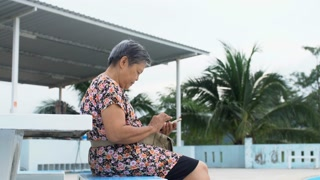 Asian senior woman using smart phone, Happy asian old