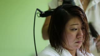 Asian woman at the beauty salon getting a blower