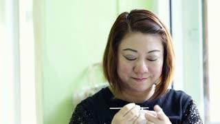 Asian woman hand Knitting Tracking Shot