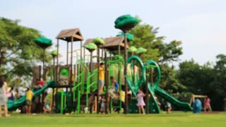 children play on the playground in Thailand park.