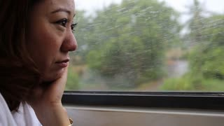 Close Up of Asian Woman's Face On A Train, Smiling At The View