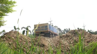 Dump truck is unloading soil. Dumper truck is unloading soil or sand at construction site.