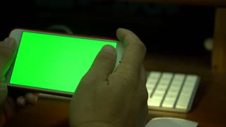 Female hand Using a Smart Phone with a Green Screen