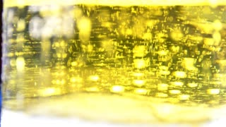 Glass full of beer slow moving bubbles 4K 3840X2160 UltraHD footage - Bubbles and foam moving fast in glass of beer 4K 2160p UHD video