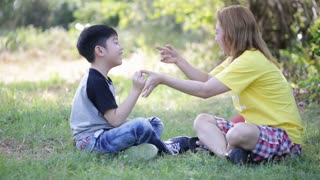 Happy asian child and mother playing in the park