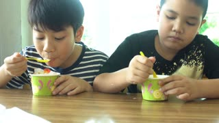 Happy asian child enjoy eating ice-cream together