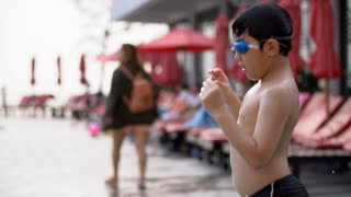 Happy asian child running and jumping in to the pool.Slow motion 120 FPS