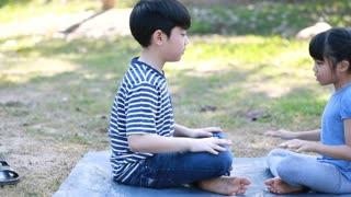 Happy asian Children Playing In Garden