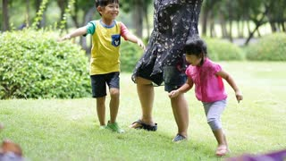 happy Asian family playing together in a park,Bangkok Thailand