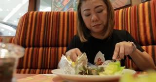 Happy Asian woman enjoy eating salad