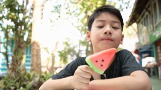 Little Asian boy enjoy with icecream .