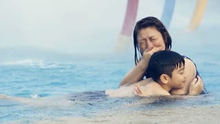 Little asian boy learning how to swimming with his mother